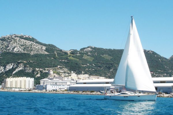 yacht on the sea with rock of gibraltar behind