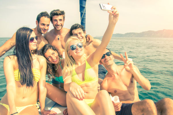 Group of friends on a boat taking a selfie