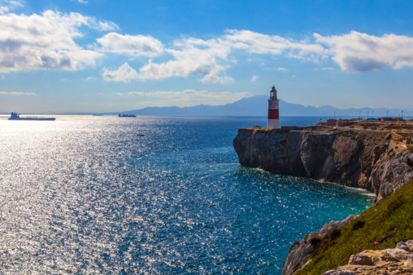 Lighthouse of Europa Point in Gibraltar overlooking the Strait with Morocco in background